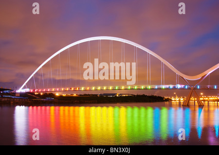 Nighttime view of floodlit Infinity Bridge over the River Tees in Stockton-on-Tees.