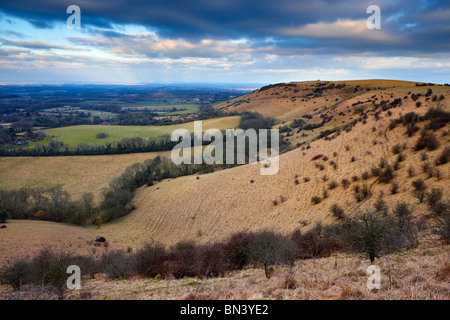 The undulating hillside of the South Downs National Park looking eastward from Ditchling Beacon along the South - Stock Photo