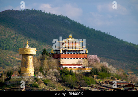 Guishan Temple and giant prayer wheel in evening light Zhongdian Yunnan China - Stock Photo