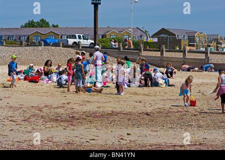 Group Of Young Schoolchildren On The Beach Littlehampton West Sussex England - Stock Photo