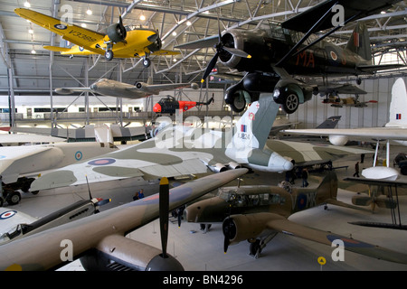 Aircraft exhibits in Airspace hangar at imperial war museum duxford - Stock Photo
