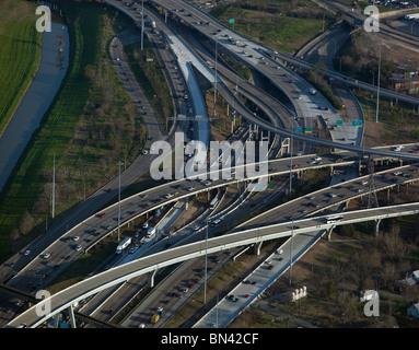 aerial view above heavy commuter automobile trafffic freeway Houston Texas - Stock Photo
