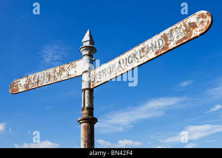 Signpost pointing east to Bishop Auckland and west to Howden and Crook near the village of Witton Park, Weardale, - Stock Photo