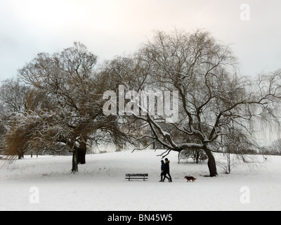 Snow and ice in Winter on Hampstead Heath ponds in London England UK - Stock Photo