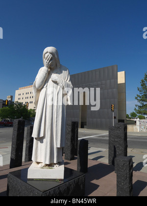 The sculpture entitled 'And Jesus Wept' adjacent to the Oklahoma City National Memorial. - Stock Photo