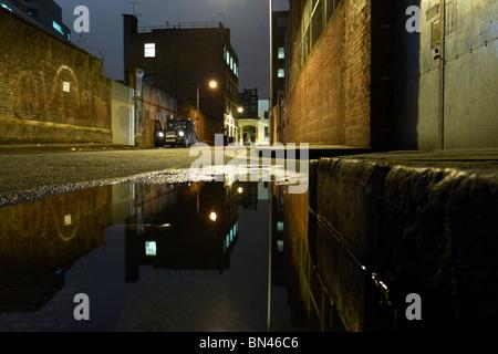 dark dingy back street in london england uk - Stock Photo