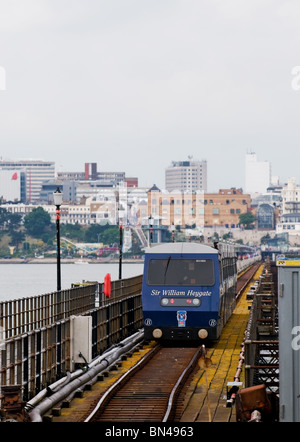 One of the electric trains arriving at the pierhead platform on Southend Pier in Essex. - Stock Photo