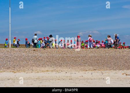 Schoolchildren On A Trip To The Seaside Littlehampton West Sussex England uk - Stock Photo
