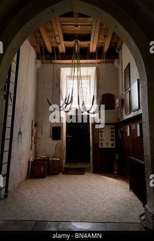 bell ropes at the bottom of the bell tower in St Mary's Church, Selborne - Stock Photo