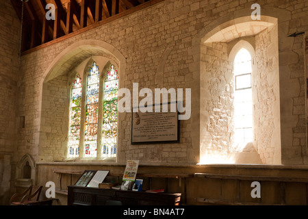 window and stained glass window to St Francis in the church of St Mary in Selborne - Stock Photo