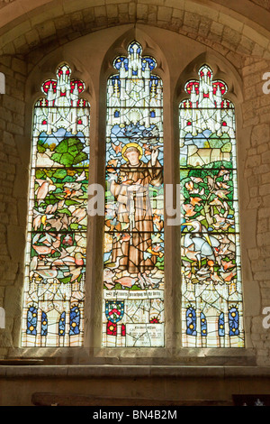 Stained glass window to St Francis in the church of St Mary in Selborne - Stock Photo