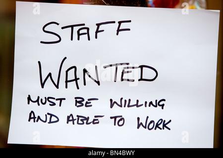 Staff wanted notice in shop window.Salisbury Wiltshire England - Stock Photo