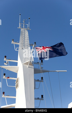 The Blue Ensign flag flown on the Main Mast of the Cunard Liner 'Queen Victoria' - Stock Photo