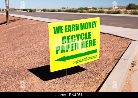 A sign directs the public to a location were paper products are collected for recycling. This is a local fund raising - Stock Photo