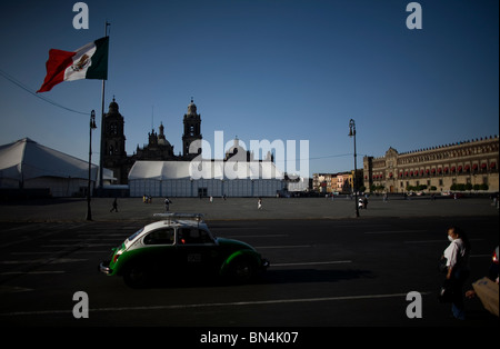 A woman wears a mask as a precaution against swine flu in the Zocalo, Mexico City's main plaza, May 2, 2009. - Stock Photo