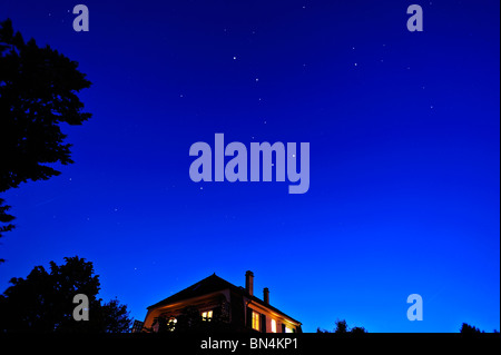The evening sky looking north, with Ursa major, Ursa minor and Polaris in view. Space for text on the sky. - Stock Photo