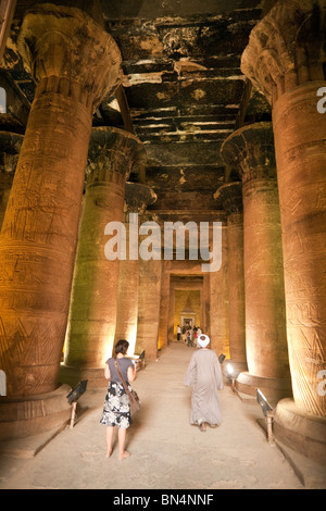Tourists and guides in the Hypostyle Hall, Temple of Horus at Edfu, Upper Egypt - Stock Photo