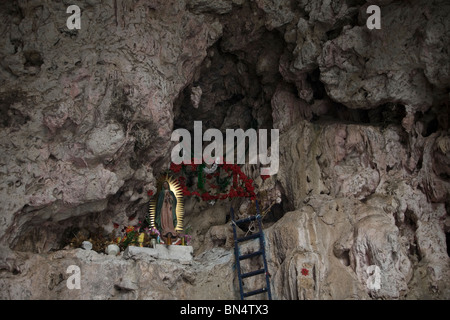 An altar to Our Lady of Guadalupe in a cave in the Sumidero Canyon in Tuxla Gutierrez, Chiapas, Mexico, February - Stock Photo
