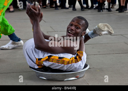 Street Entertainer (Contortionist), South Bank, London, England - Stock Photo