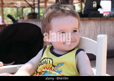 Cheeky little boy smiling - Stock Photo