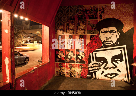 Shepard Fairey Paste Mural in Austin, Texas at the bar Red 7 - Stock Photo