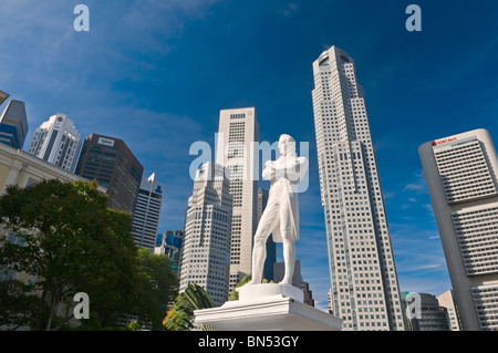 Sir Stamford Raffles statue and Central Business District Singapore - Stock Photo