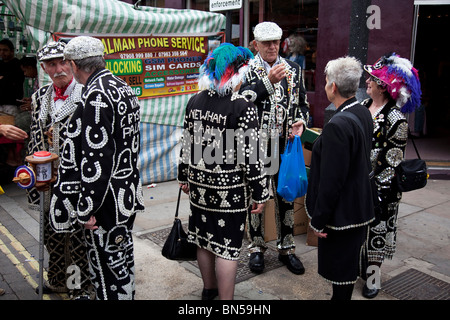 Pearly Kings and Queens in the East End of London. They are an organised charitable tradition of working class culture - Stock Photo