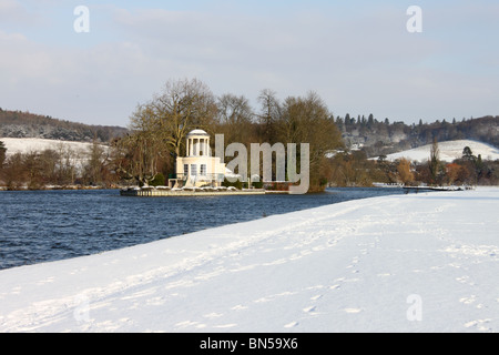 View to Temple Island in snow from tow path across River Thames, with Chiltern Hills behind, Henley on Thames, Oxfordshire - Stock Photo