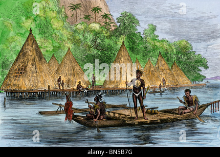 Native village on Humboldt Bay, Papua New Guinea, 1800s. Hand-colored woodcut - Stock Photo