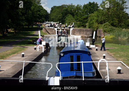 Canal boats on The Grand Union Canal at Hatton Warwickshire where the famous locks are located - Stock Photo