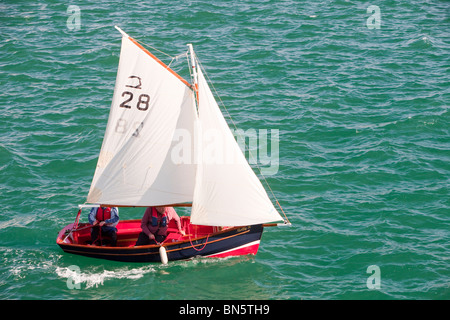 A couple sailing in a small boat off Penzance, Cornwall, UK. - Stock Photo