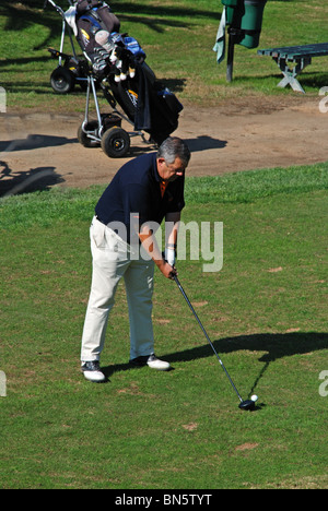 Golfer at the Rio Real Golf Club, Marbella, Costa del Sol, Malaga Province, Andalucia, Spain, Western Europe. - Stock Photo