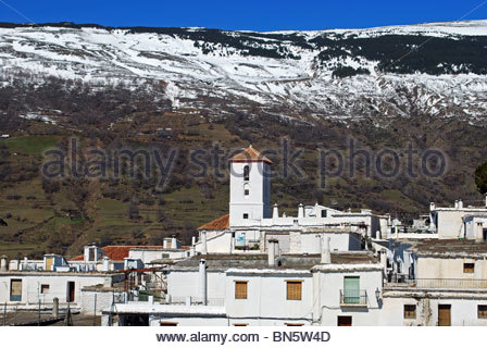 View over the town rooftops towards the church, Capileira, Las Alpujarras, Granada Province, Andalucia, Spain, Western - Stock Photo