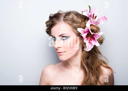Close-up of beautiful girl with flowers On white background - Stock Photo