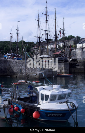Fishing boat and tall ships in Charlestown Harbour. Cornwall. UK - Stock Photo