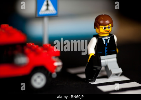 Lego man on zebra crossing - Stock Photo