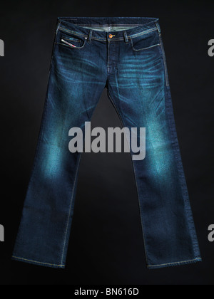 Diesel jeans Zathan. Men boot cut washed denim pants isolated on black background. - Stock Photo