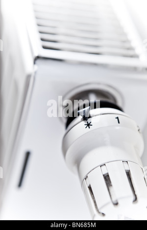 Radiator adjustment close-up - adjusting heater temperature - Stock Photo