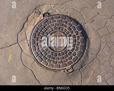 Rusty sewer manhole in Moscow, Russia - Stock Photo