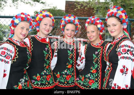 Beautiful Ukrainian women with colorful tradiional costumes - Stock Photo