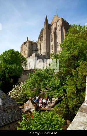 The Abbey of St. Michel on the Mont-St-Michel, tourists climbing up the stairs - Stock Photo