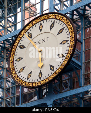 The famous clock made by Dent which hangs on St Pancras International Station in London England UK reconstructed - Stock Photo