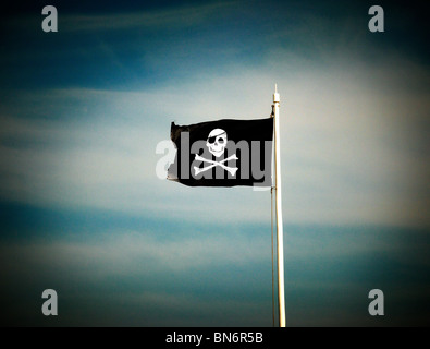 a pirate flag also knows as the jolly roger - Stock Photo