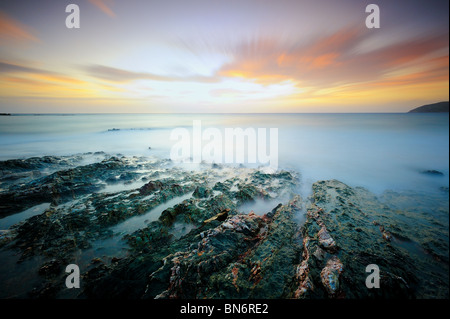 Moody seascape at sunset - Stock Photo