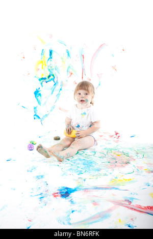 2 year old girl having fun with paints - Stock Photo