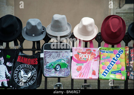 Hats and bags, for sale  hanging on a fence on a market stall in Cambridge UK - Stock Photo
