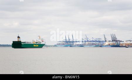 A ship enters The Port of Felixstowe, Suffolk, England. - Stock Photo