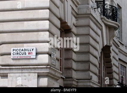 A street sign on the wall of a building at Picadilly Circus in London. - Stock Photo