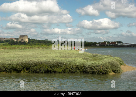 The riverbank of the River Adur with Lancing College and the South Downs in the background. - Stock Photo