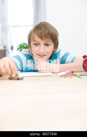 Boy playing with little car - Stock Photo